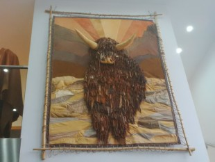Picture of a Highland cow done in leather