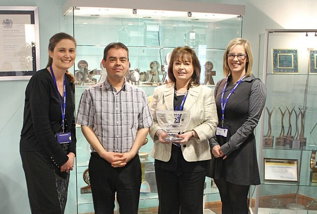 The Allstate NI team holding their 2005 Queen's Award.