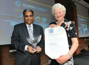 Dame Mary Peters, presents the award to Allstate's Suren Gupta