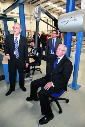 The Duke of Gloucester tests a robotic arm.
