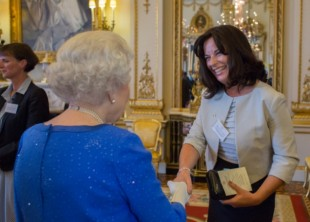 Jayne Taggart shakes hands with the Queen.