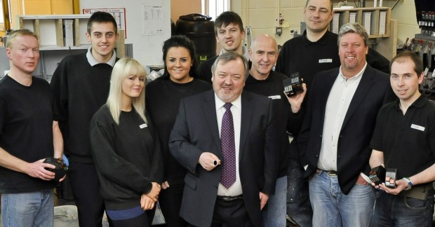 David Hymers with the Totalpost manufacturing team.