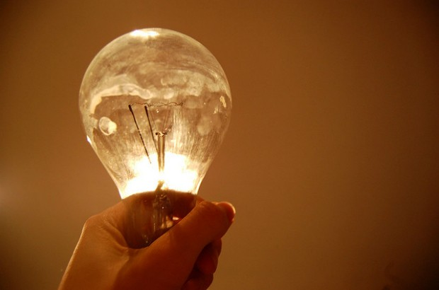 Hand holding a lightbulb.
