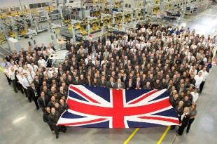 Workers at Jaguar Land Rover holding a Union Jack.