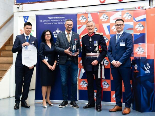 EasySkinz being presented with their Queen's Awards trophy by Lord Leutenant Nigel Atkinson Esq